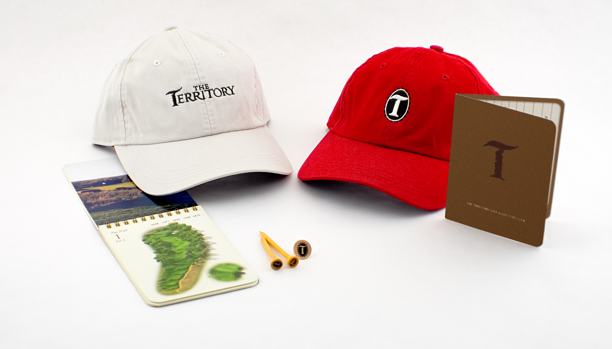 MERCHANDISE DESIGN - The Territory Golf & Country Club | hats, score pad - ©UnParalleled, LLC dba UP-Ideas / Roger Sawhill / Mark Braught - Atlanta, Georgia | Lawrenceville, Georgia | Commerce, Georgia